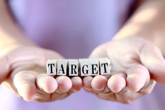 Target word on woman hand. Royalty Free Stock Photo