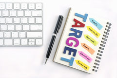 Target written on the notebook with pen Royalty Free Stock Images