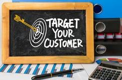 Target your customer hand drawing on blackboard Stock Photo