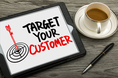 Target your customer hand drawing on tablet pc Royalty Free Stock Photos