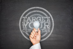 Target your customers on Blackboard Royalty Free Stock Image