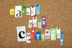 TARGET YOUR CUSTOMERS. Single letters pinned on cork noticeboard Stock Photo
