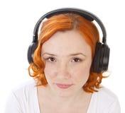 target1470_1_ muzycznej rudzielec dziewczyna hełmofony obraz stock