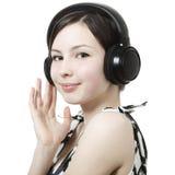 target2391_1_ muzykę dziewczyna hełmofony obraz stock
