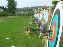 Targets. Archery targets in row with arrows stock images