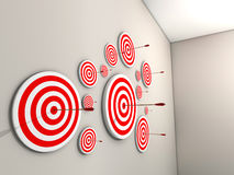 Targets. A lot of targets with arrows on wall - 3d render Royalty Free Stock Image