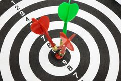 Targets with arrow in the center. Targets with arrow in the center of dartboard on white background Stock Photo