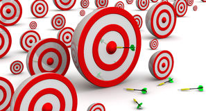 Targets of various sizes. Hit the target. The targets of different sizes on a white surface with darts Stock Photos