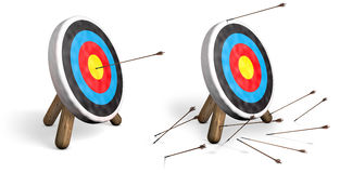 Targets on White. Two archery targets on white, one with bulls eyes and another with all arrows missing the target Royalty Free Stock Image