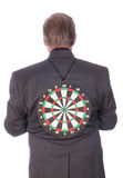 Targetted man. Businessman with target on his back royalty free stock photo