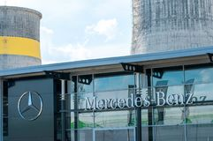Mercedes Benz  logo on the street. Targu Mures, Romania-01 June 2018: Mercedes Benz  logo on the street, fertiliser power plant on the background Royalty Free Stock Image