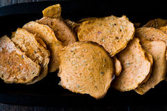 Tarhana cipsi / chips or crackers in a wooden bowl. royalty free stock photo