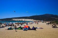 TARIFA COSTA DE LA LUZ, PLAYA DE BOLONIA, SPAIN - JUNE, 18. 2016: Kite surfers on the beach in Spain royalty free stock image
