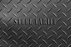 Tarifa de aço das palavras escrita na chapa de aço textured com conceito da disputa da tarifa de aço da placa pattern/USA do diam fotografia de stock royalty free