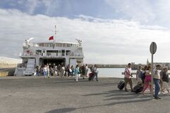 Free TARIFA, SPAIN, MARCH 18, 2019: Tourists Descending From The Ferry Returning From Tangier, Morocco. Stock Photography - 178583872