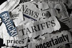 Tariff news headlines. Newspaper scraps with Tariff and economy related headlines royalty free stock photography