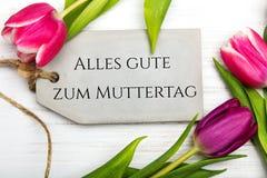 Tarjeta alemana del día del ` s de la madre con la palabra Muttertag Foto de archivo libre de regalías