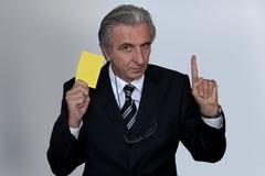 Tarjeta amarilla. Imagen de archivo libre de regalías