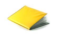 Tarjeta amarilla de la cartera Fotos de archivo libres de regalías