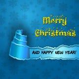 Tarjeta azul con el árbol de navidad hecho del papel rasgado Imagenes de archivo