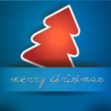 Tarjeta azul de la Feliz Navidad con el árbol rojo Imagenes de archivo