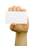 Tarjeta blanca en una mano Fotos de archivo