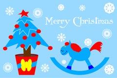 tarjeta con el árbol de navidad y el caballo de madera azul imagenes de archivo