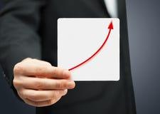 Tarjeta con el aumento del gráfico en él Fotos de archivo libres de regalías