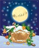 Tarjeta con la luna de Navidad, copos de nieve, pan de jengibre Fotografía de archivo libre de regalías