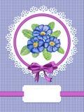 Tarjeta con las flores de la prímula Foto de archivo libre de regalías