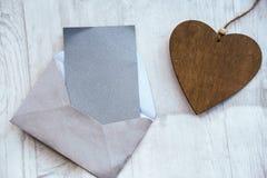 Tarjeta con un corazón Fotos de archivo