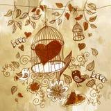 Tarjeta con una jaula de pájaros y el corazón Fotos de archivo libres de regalías