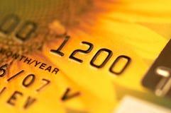 Tarjeta de actividades bancarias en macro Imagen de archivo libre de regalías