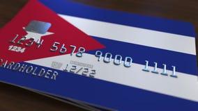 Tarjeta de banco plástica que ofrece la bandera de Cuba Animación conceptual del sistema bancario cubano libre illustration