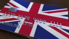 Tarjeta de banco plástica que ofrece la bandera de Gran Bretaña Animación relacionada al sistema de las actividades bancarias nac ilustración del vector