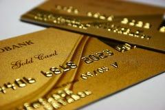 Tarjeta de batería del oro Imágenes de archivo libres de regalías