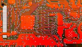 Tarjeta de circuitos roja Fotos de archivo libres de regalías