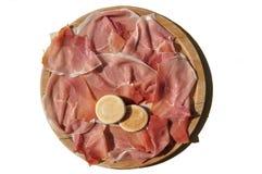 Tarjeta de corte con el jamón de Parma Imagen de archivo libre de regalías