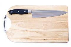 Tarjeta de corte con un cuchillo fotografía de archivo libre de regalías