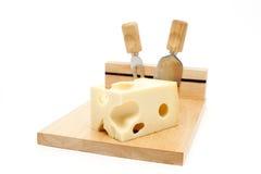 Tarjeta de corte del queso Imágenes de archivo libres de regalías