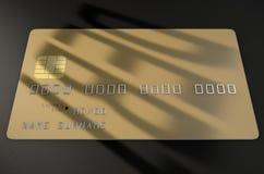 Tarjeta de crédito de la sombra de la deuda Fotos de archivo libres de regalías