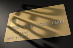 Tarjeta de crédito de la sombra de la deuda Fotos de archivo