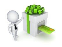 Tarjeta de crédito insertada en un rectángulo de regalo. Foto de archivo