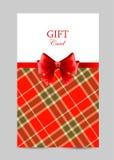 Tarjeta de felicitación con el arco rojo, tartán Fotos de archivo libres de regalías