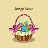 Tarjeta de felicitación con el conejito de pascua en una cesta Imagen de archivo