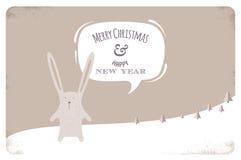 Tarjeta de felicitación con el conejo de la Navidad Fotos de archivo libres de regalías