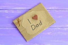Tarjeta de felicitación con el papá del amor del texto I Foto de archivo