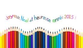 Tarjeta de felicitación con el texto francés que significa la tarjeta 2015, lápices coloridos de felicitación de la Feliz Año Nue Imagen de archivo libre de regalías