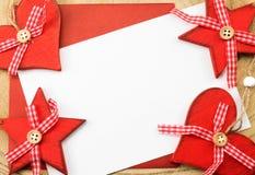 Tarjeta de felicitación con la decoración de la Navidad Fotos de archivo