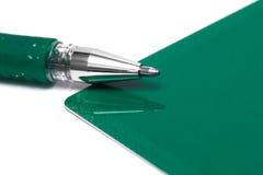 Tarjeta de felicitación con la pluma Foto de archivo libre de regalías